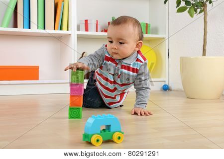 Baby Playing With Cubes And Bricks