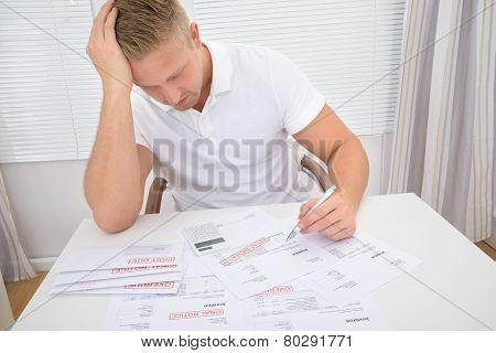 Worried Man Calculating Bills