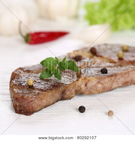Roasted Pork Chop Steak Meat On A Wooden Table