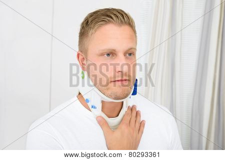 Young Man Wearing Cervical Collar