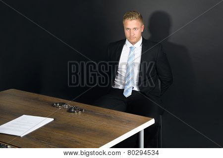 Businessman In Interrogation Room