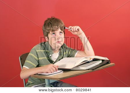frustrated student at his desk