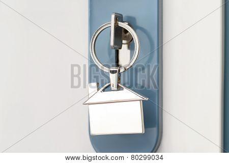 Finger Inserting Key In Keyhole