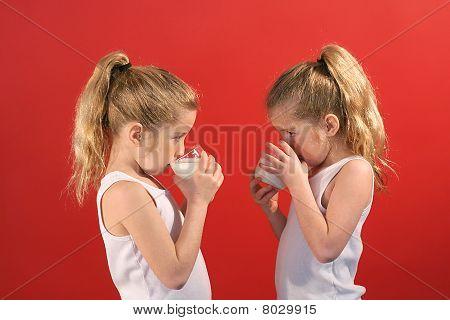twins drinking milk
