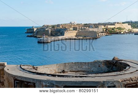 View From Fort St Elmo On To The Ricasoli Grand Harbour East Breakwater And Red Lighthouse