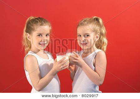 twins drinking milk smile