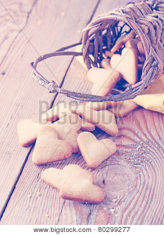 Handmade Heart Cookies For Valentine's Day In A Basket Lying On A Wooden Table