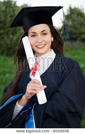 Happy Young Smiley Graduate Girl Outdoors