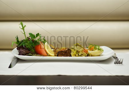 Aegean-style Vegetables On White Plate With Cutlery