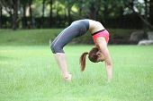 stock photo of dhanurasana  - Young woman practicing yoga  - JPG