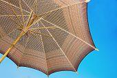 stock photo of handicrafts  - Thailand pattern silk umbrella and sky blue art artist handicraft beach - JPG