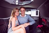 image of limousine  - Happy couple smiling in limousine on a night out - JPG