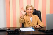 Happy Senior Businesswoman Showing Okay Sign Hand