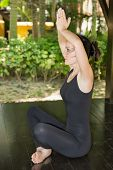 stock photo of pilates  - Young woman is practicing yoga and pilates on nature - JPG
