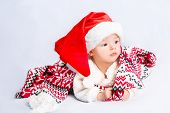 picture of christmas baby  - Beautiful little baby celebrates Christmas - JPG