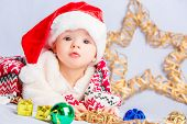 image of christmas baby  - Beautiful little baby celebrates Christmas. New Year
