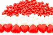 stock photo of jelly beans  - Valentine candies of June and Cinnamon Hearts and white jelly beans on white background - JPG
