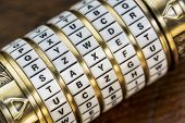 stock photo of combinations  - taxes word as a password to combination puzzle box with rings of letters - JPG