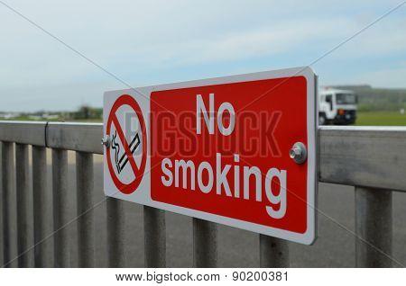 No smoking sign beside airport runway