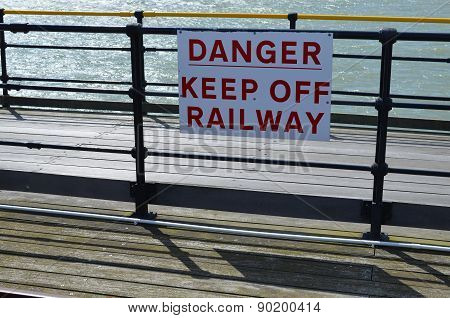 Danger keep off railway sign