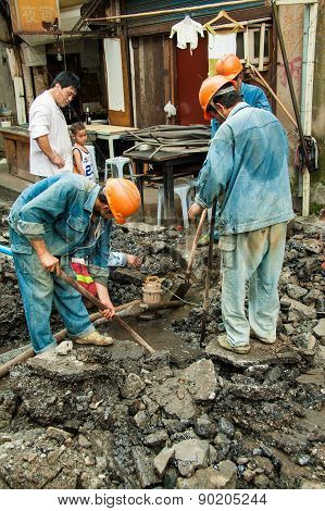 Street Workers In The Old Center Of Shanghai, China