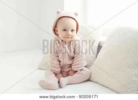 Portrait Of Smiling Baby At Home In White Room