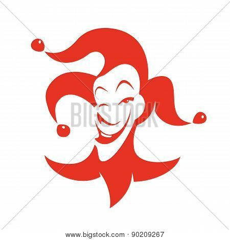 Red joker with a sly look and a smile.