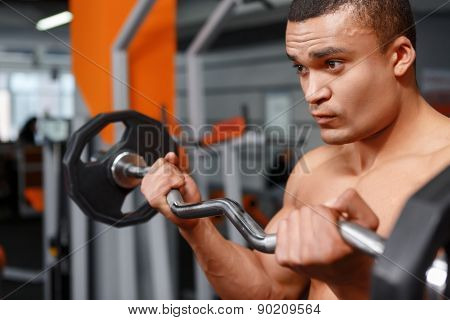 Portrait of weightlifter with barbell in his hands