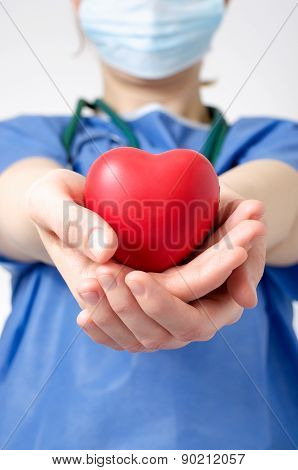 Doctor Holding A Heart Shape