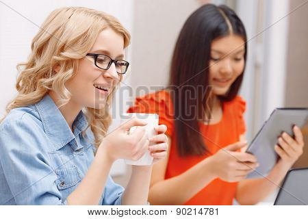 Two young women working on a project