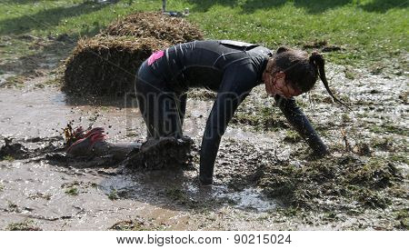 Woman Crawling On Her Knees Through The Mud