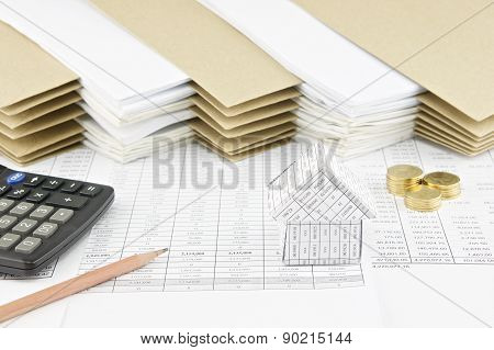 Pencil And House With Calculator And Pile Of Gold Coins
