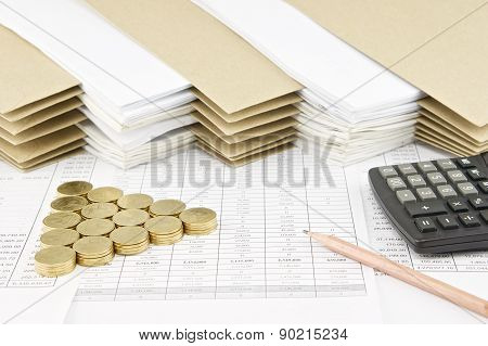 Pencil And Pile Of Gold Coins As Triangle With Calculator