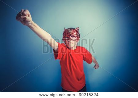 European-looking  boy  of twelve  hand  up, super hero mask on a