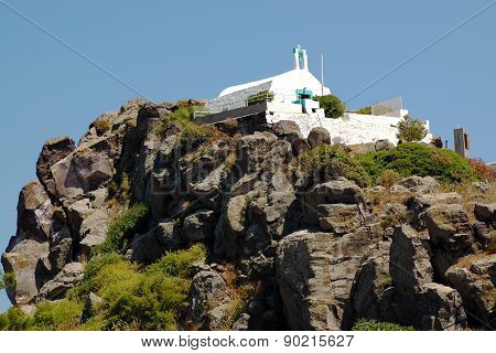 Small Greek church on the cliff