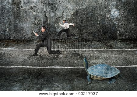 Two Businessmen Running With Turtle In Dark Concrete Room