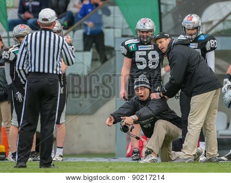 INNSBRUCK, AUSTRIA - MAY 3, 2014: Head Coach Shuan Fatah (Raiders) disagrees with the spotting of the ball.