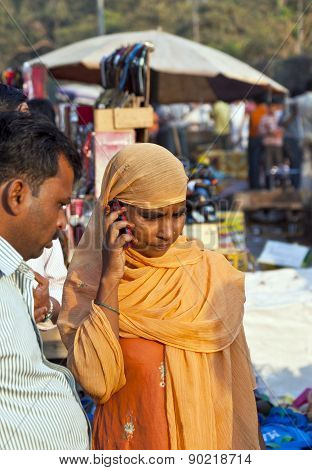 Woman Using The Mobile In The Meena Bazaar In Delhi