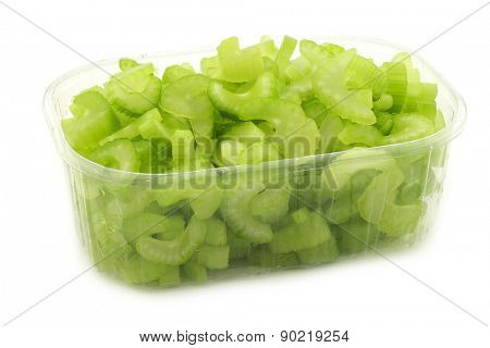 cut pieces of celery in a plastic container on a white background
