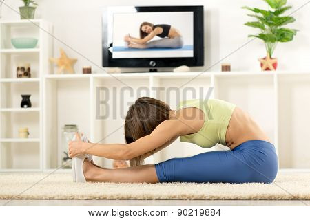 Woman Stretching In Front Of Tv
