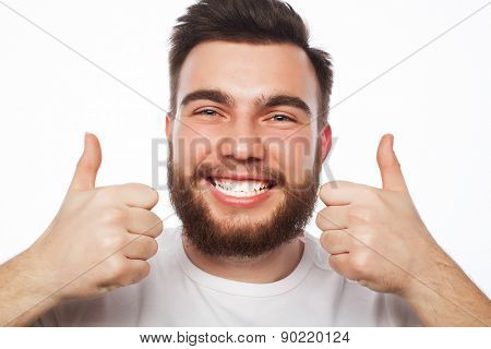 life style, education and people concept: happy man giving thumbs up sign - portrait on white background.