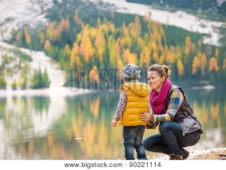 Mother Speaking To Daughter On The Shore Of Lake Bries