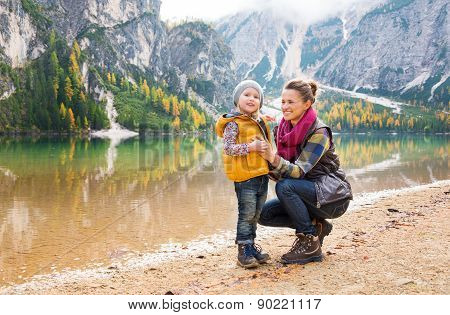 Smiling Mother And Daughter On The Shore Of Lake Bries