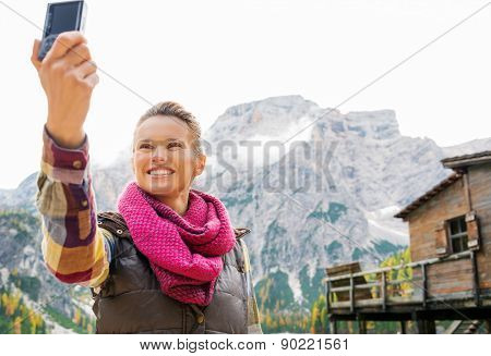 Woman On The Shores Of Lake Bries Taking A Selfie