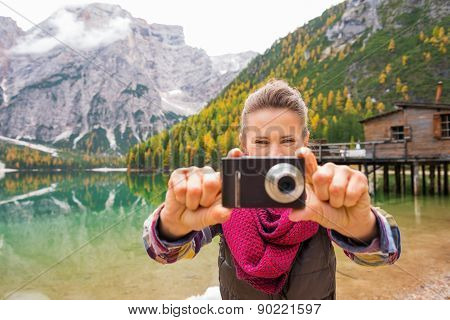 Woman On Lake Bries Aiming Digital Camera At Viewer