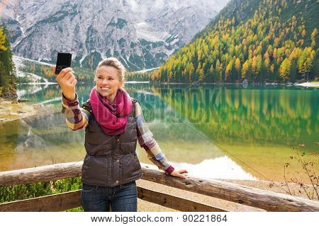 Woman Hiker Taking A Selfie At Lake Bries With Autumn Colours