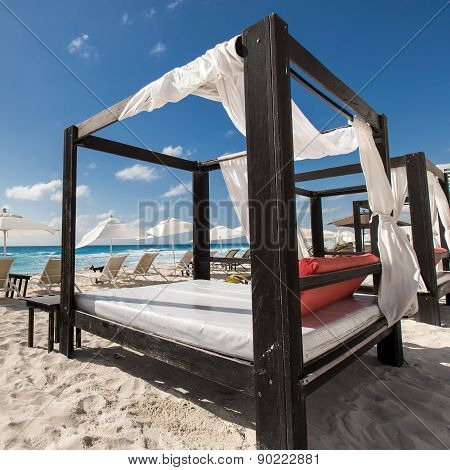 Luxury Wooden Lounge Beds On Caribbean Beach