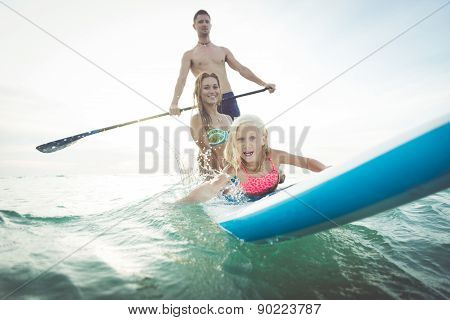 Family Making Paddle Surf In The Ocean