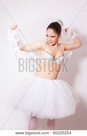Sad Bride In A Skirt, Underwear And Veil