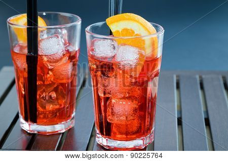 Spritz Aperitif Aperol Cocktail With Two Orange Slices And Ice Cubes